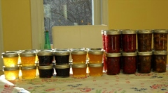 A variety of homemade fruit jellies and jams, ready for Christmas gifts.
